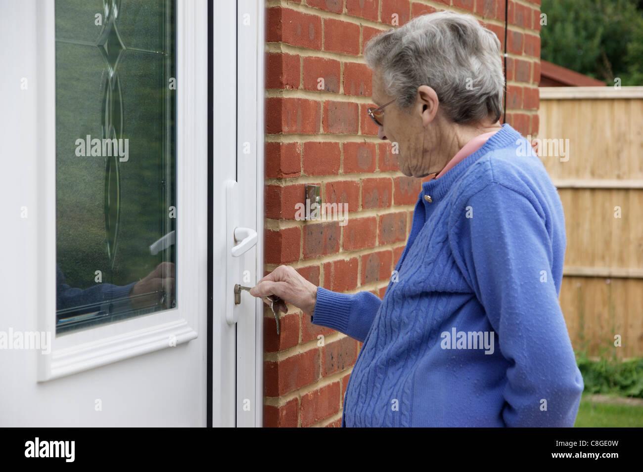Elderly Woman Locking Unlocking Front Door Stock Photo 39700217