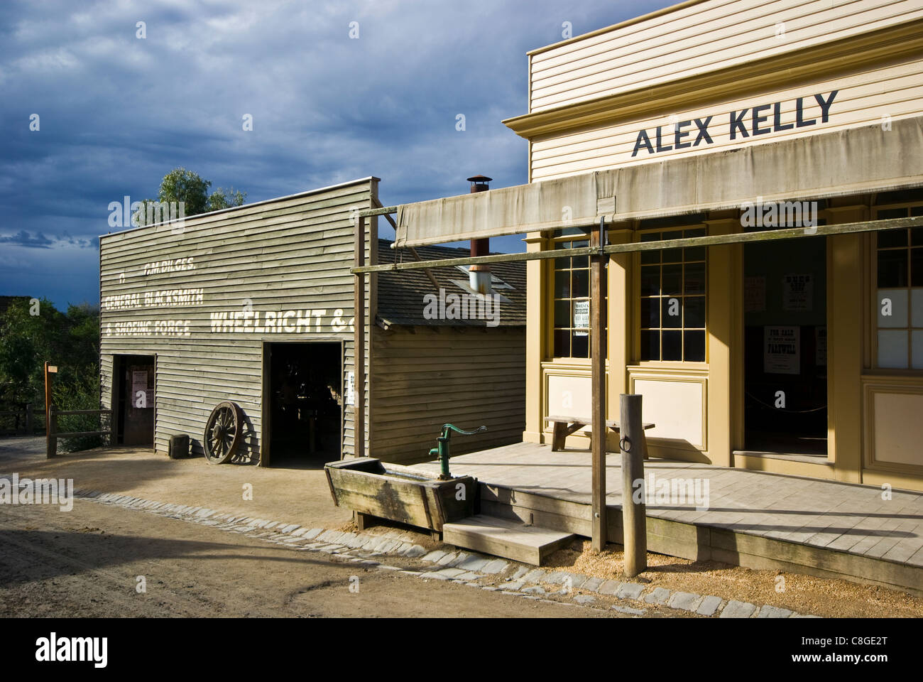 Antique stables and blacksmith wheelwright workshops on main street. - Stock Image