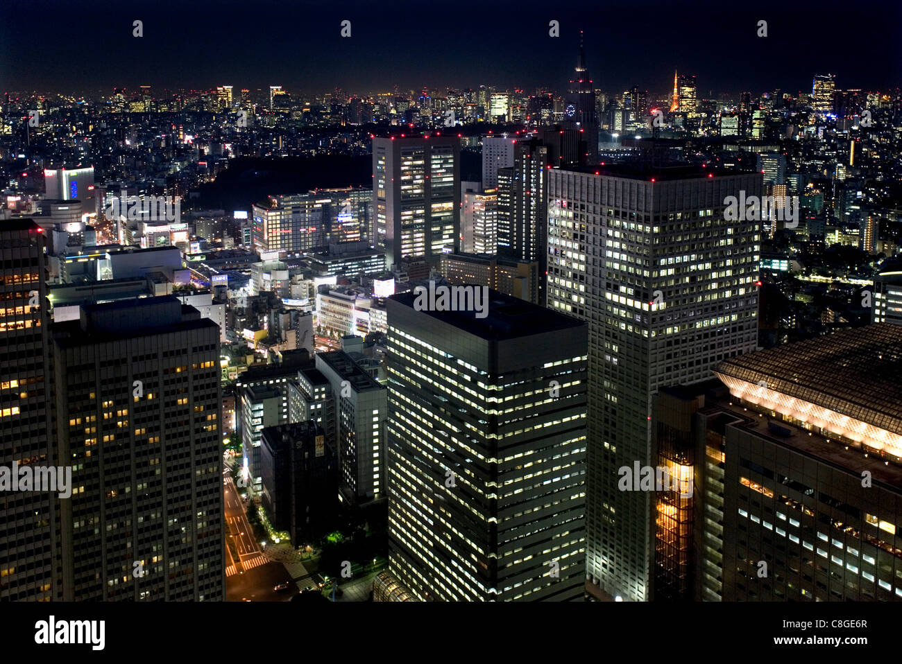 Night skyline view of Tokyo's endless urban sprawl and development near South Shinjuku, Tokyo, Japan - Stock Image