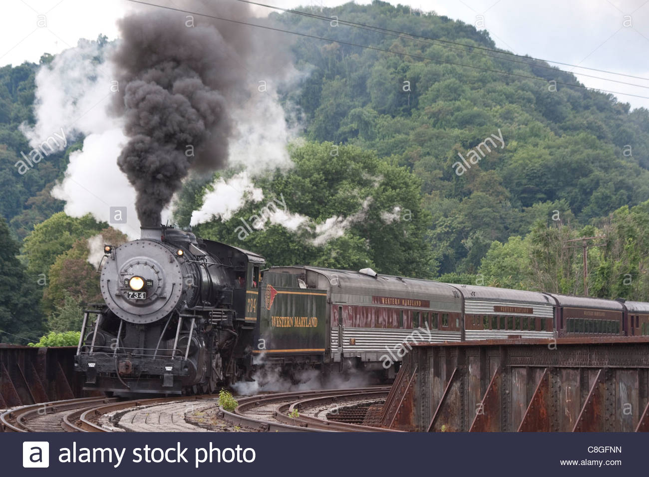Western Maryland Scenic Railraod 2-8-0 #734 crossing trestle into depot. - Stock Image