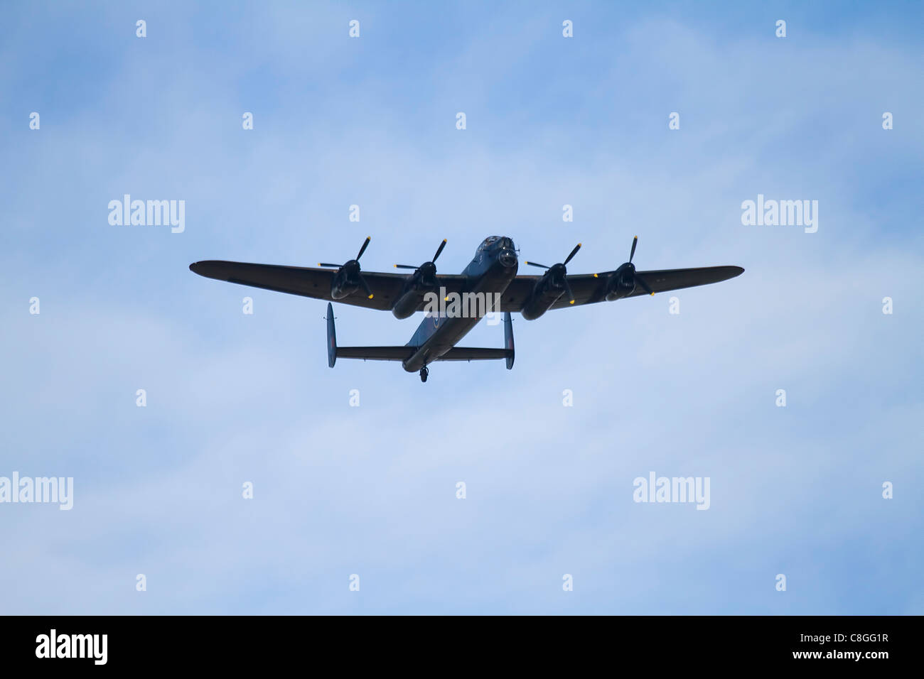 a restored WW2 lancaster bomber flying low - Stock Image