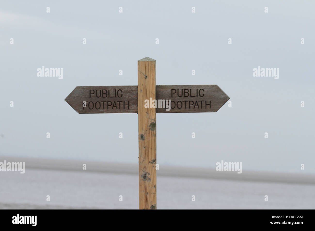 wooden public footpath signpost - Stock Image