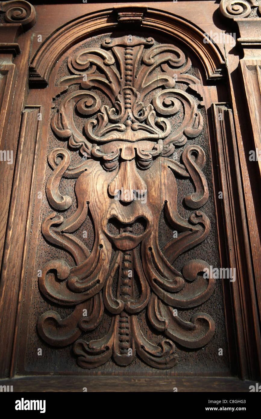 wood carving on door, Bratislava, Slovakia - Stock Image