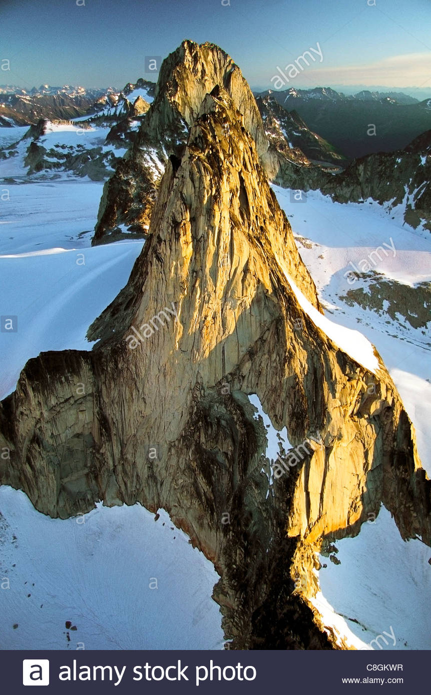 Peaks of the Bugaboos thrust above Canada's Purcell Mountains. - Stock Image