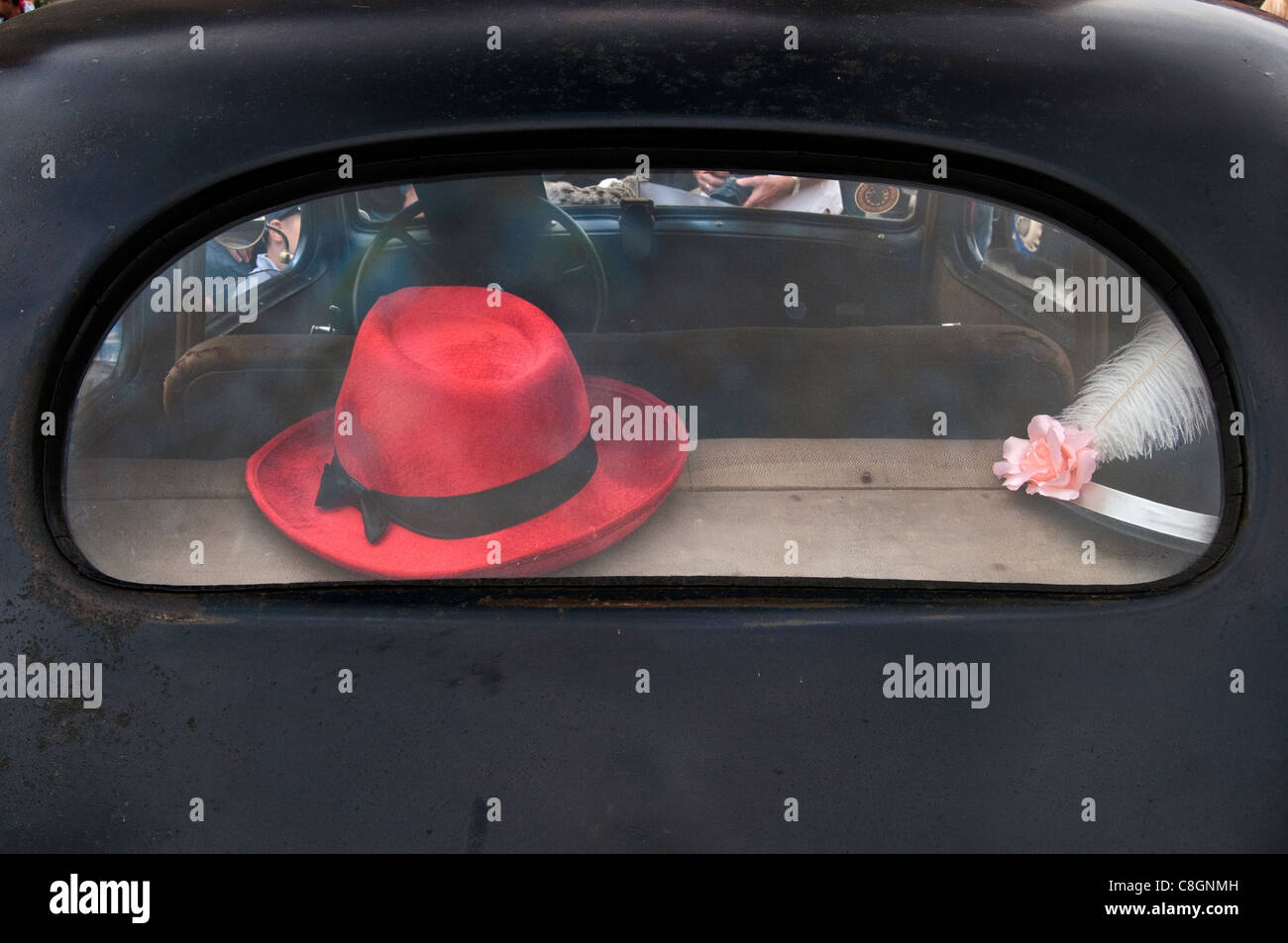 Red hat in rear window of 1930s Renault Celtaquatre, Vehicles of Interwar Poland Rally in Wroclaw, Lower Silesia, - Stock Image