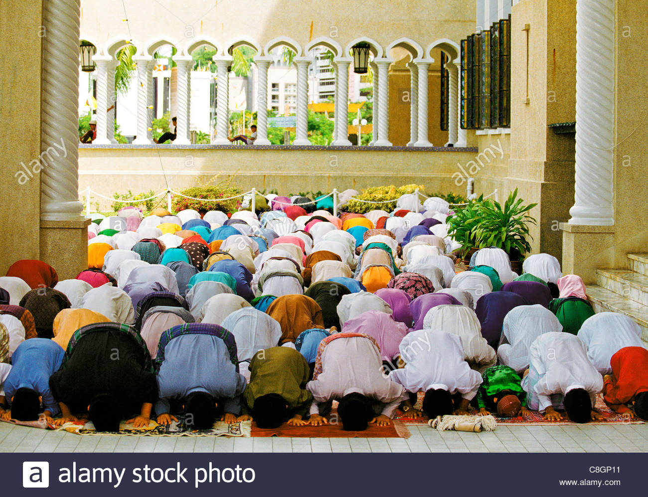 Muslims at prayer in a mosque. - Stock Image