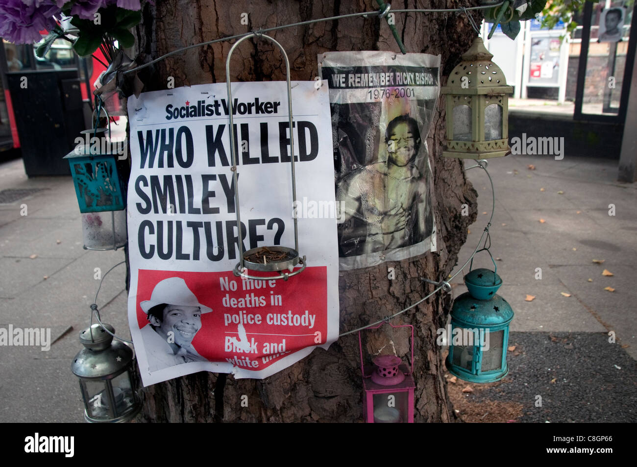 Poster and shrine outside Brixton police Station about Smiley Culture a singer who died in police custody - Stock Image