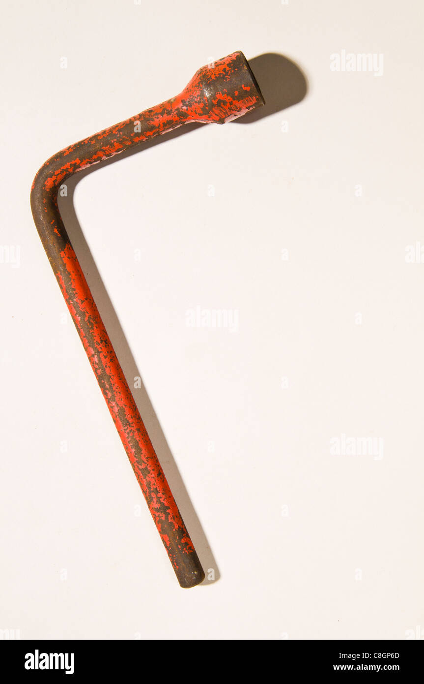 Old rusty wheel Spanner / Wrench Stock Photo