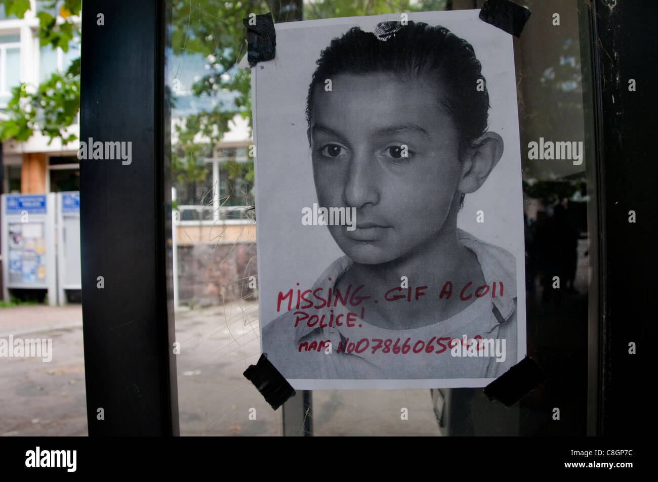 poster outside Brixton police station about missing youth in police custody - Stock Image