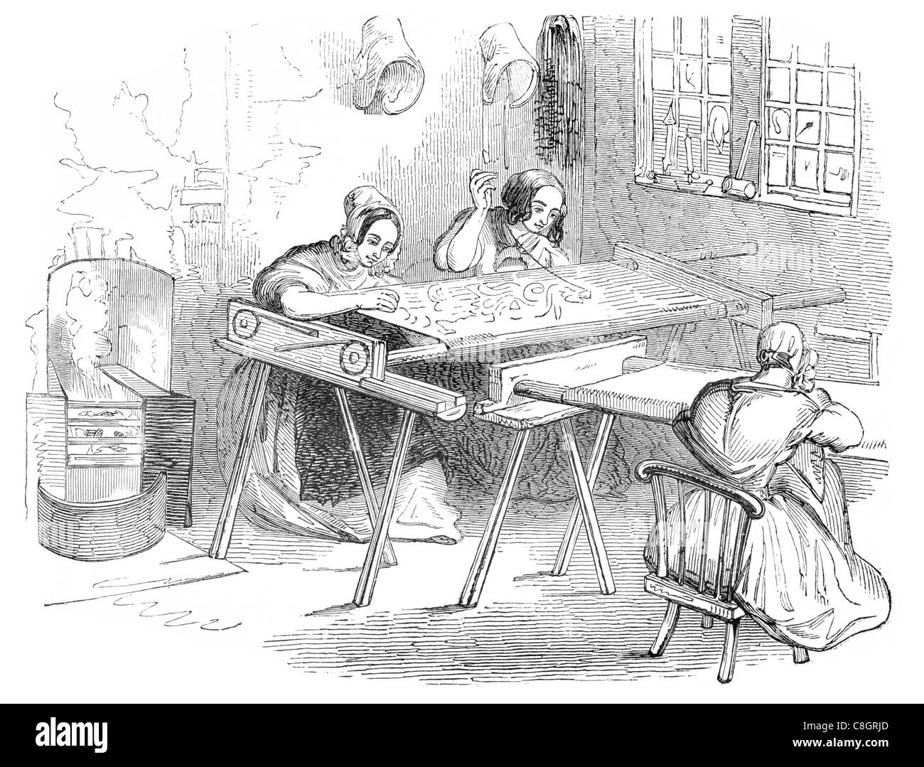 Nottingham lace running or embroidering weaving textiles textile cottage industry craft workshop weaver - Stock Image