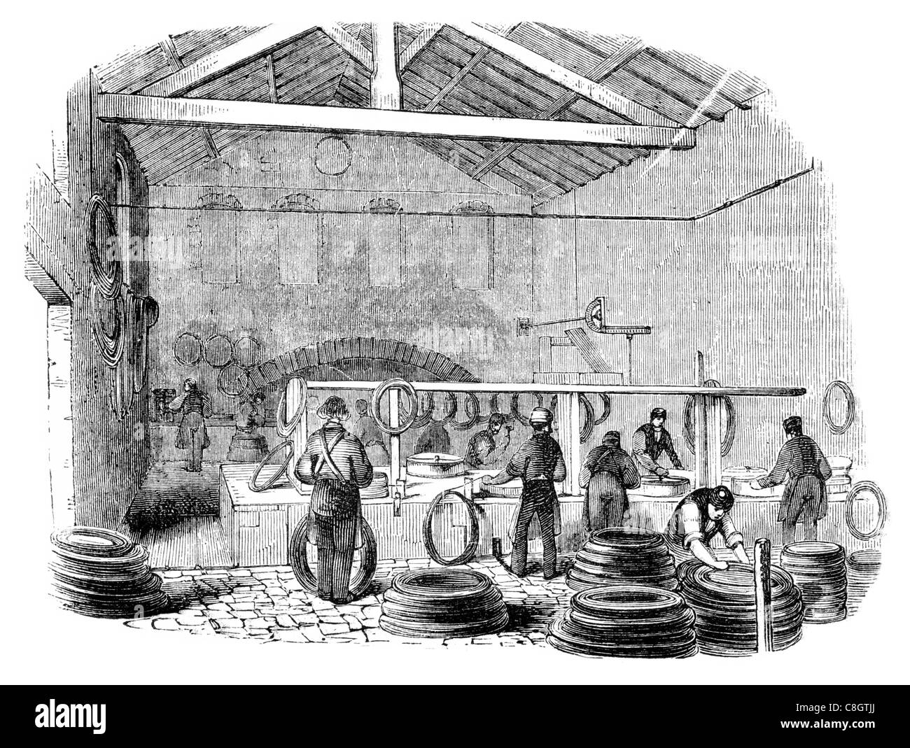 wire drawing machines Industrial Revolution machine industry factory manufacture construction workforce worker work - Stock Image
