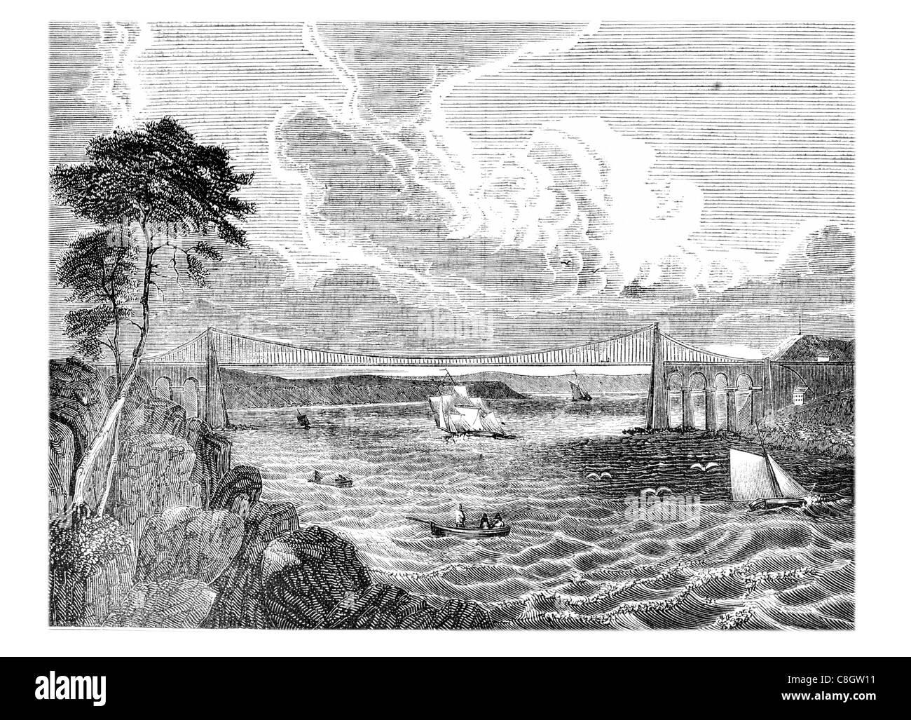 Menai Suspension Bridge Isle Anglesey north Wales Strait Thomas Telford coast costal storm waves wave ocean bay - Stock Image