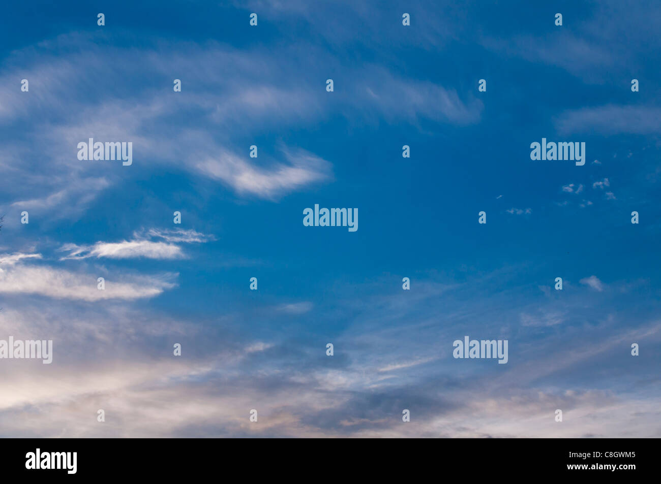 Blue sky with light clouds in the late afternoon - Stock Image