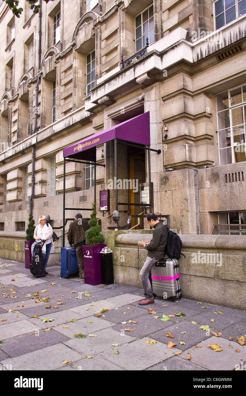 Guets with luggage outside Premier Inn, County Hall, London, October 2011 - Stock Image