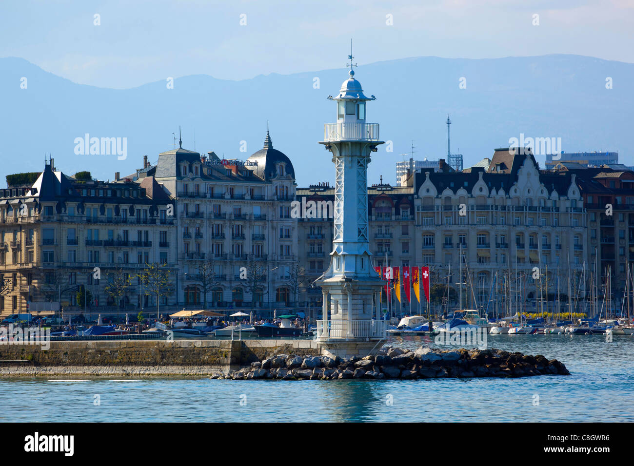 Geneva, Switzerland, Europe, canton Geneva, town, city, houses, homes, harbour, port, entrance, lighthouse - Stock Image