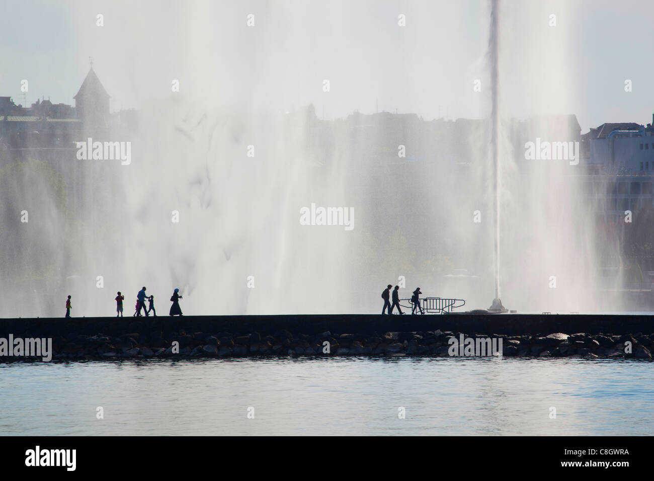 Geneva, Switzerland, Europe, canton Geneva, town, city, harbour, port, fountain, jet d'eau, persons, tourists - Stock Image