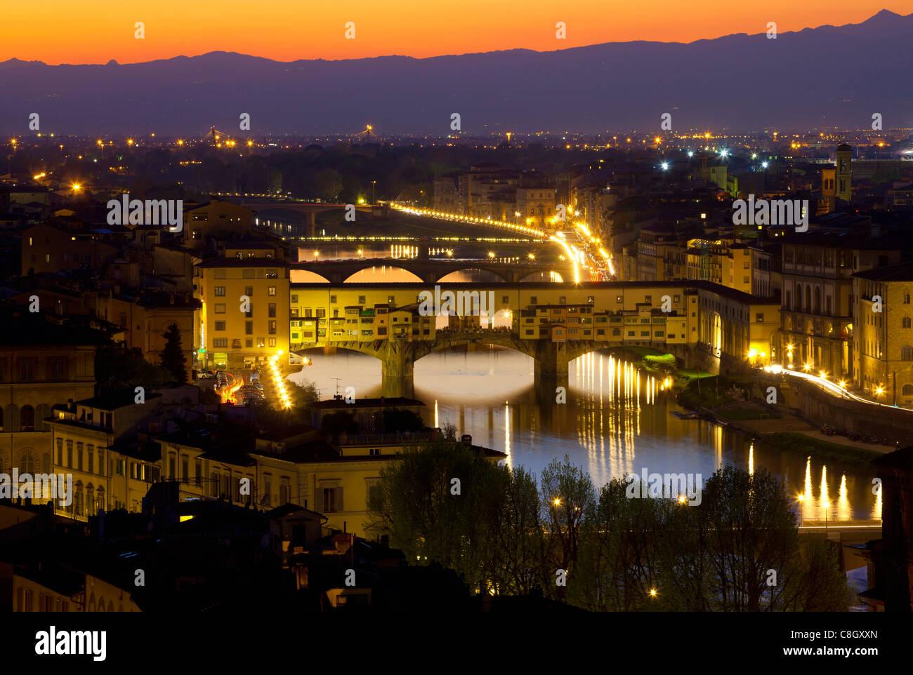 Florence, Italy, Europe, Tuscany, town, city, houses, homes, river, flow, Arno, bridges, dusk, light, illumination, - Stock Image