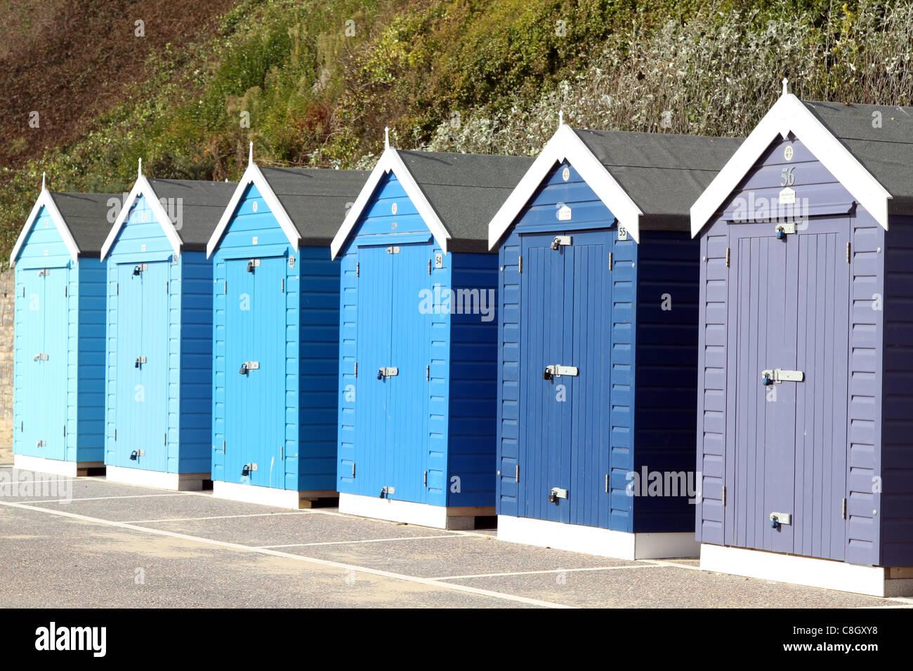 colourful beachhuts on bournemouth beach - Stock Image