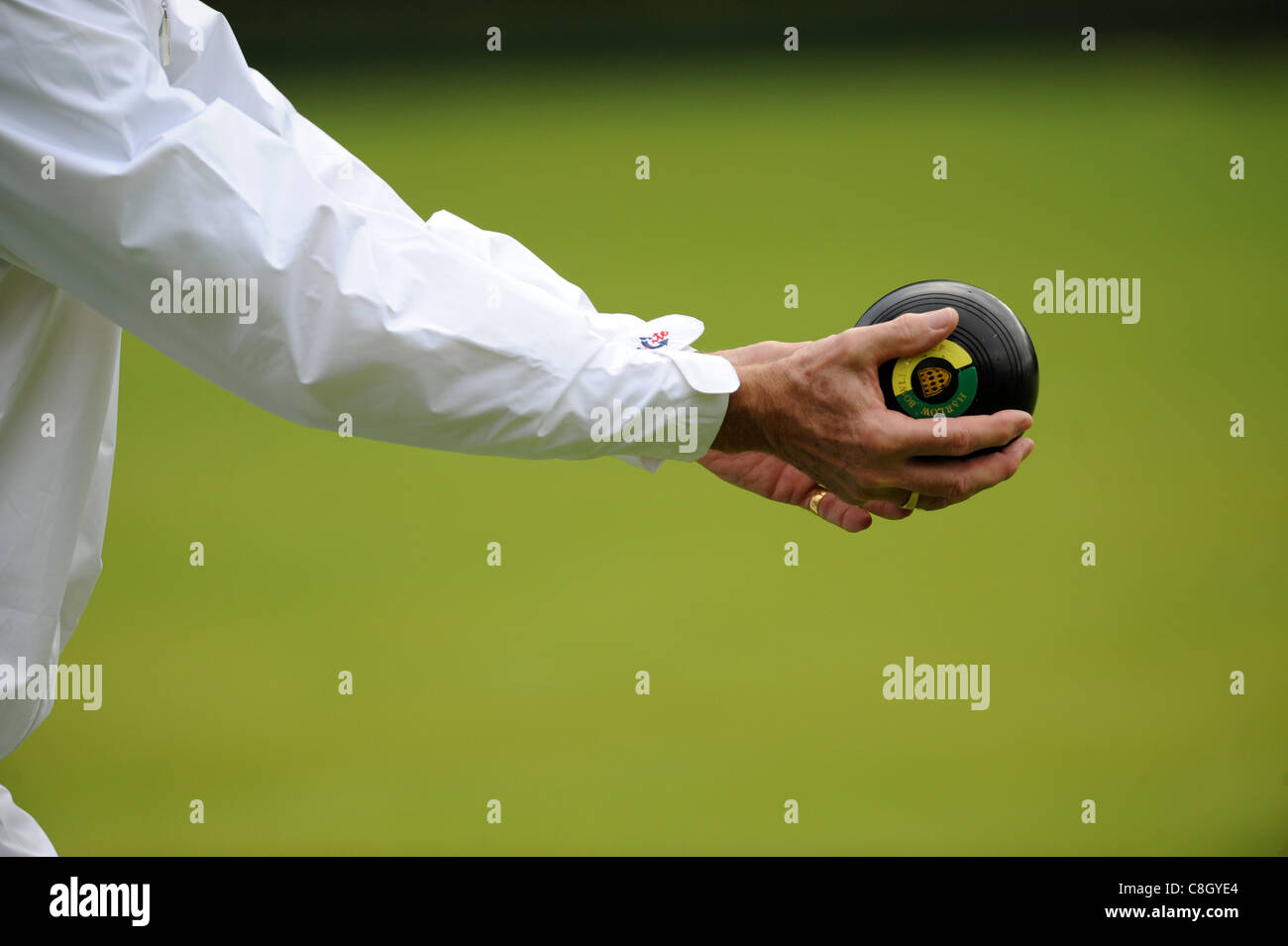 A close up of a man playing Lawn Bowls. - Stock Image