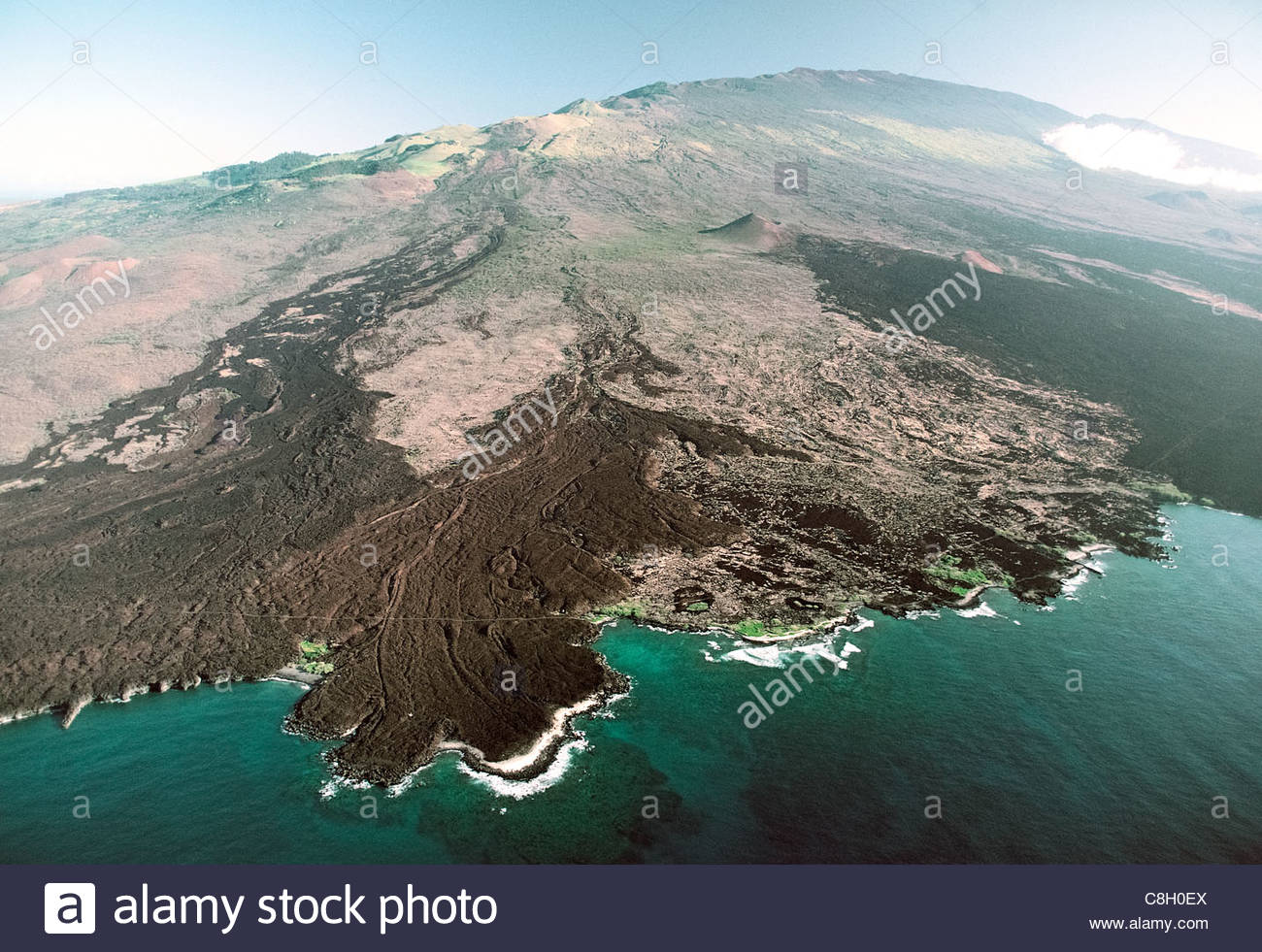 An old lava flow that reached the ocean. - Stock Image