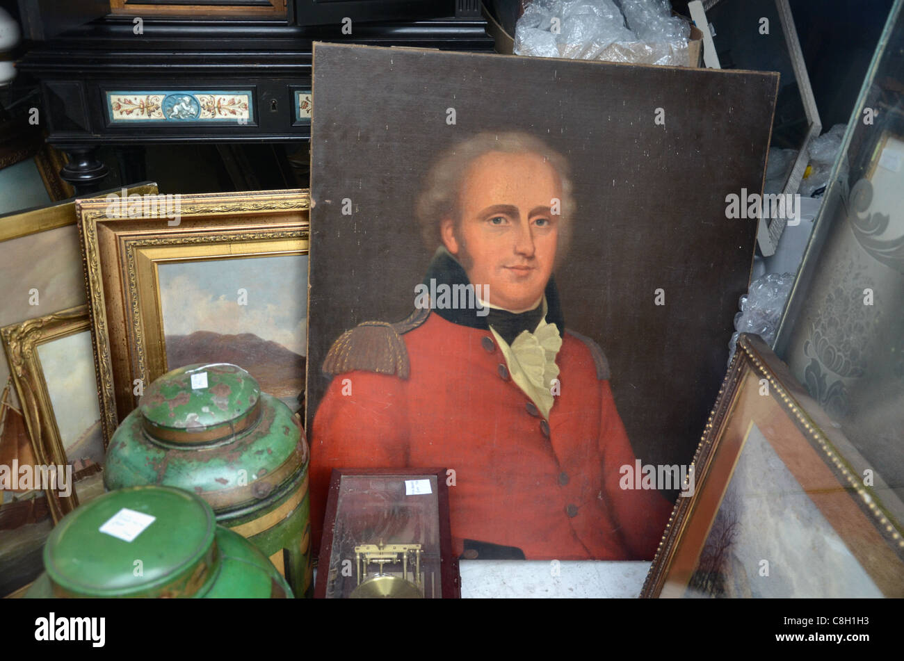 Paintings and bric-a-brac in the window of a junk shop in Edinburgh's New Town. - Stock Image