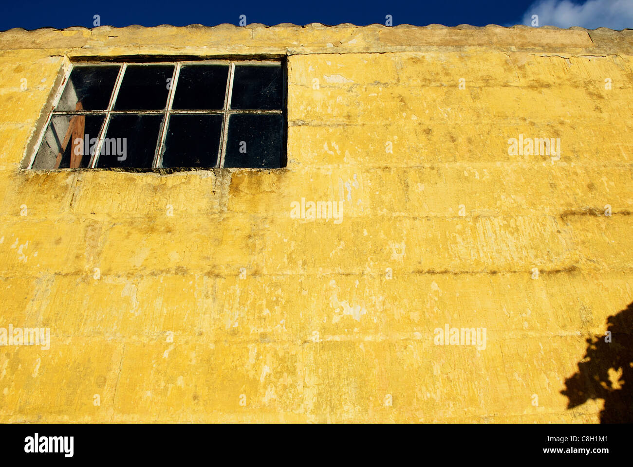 OLD YELLOW WALL - Stock Image
