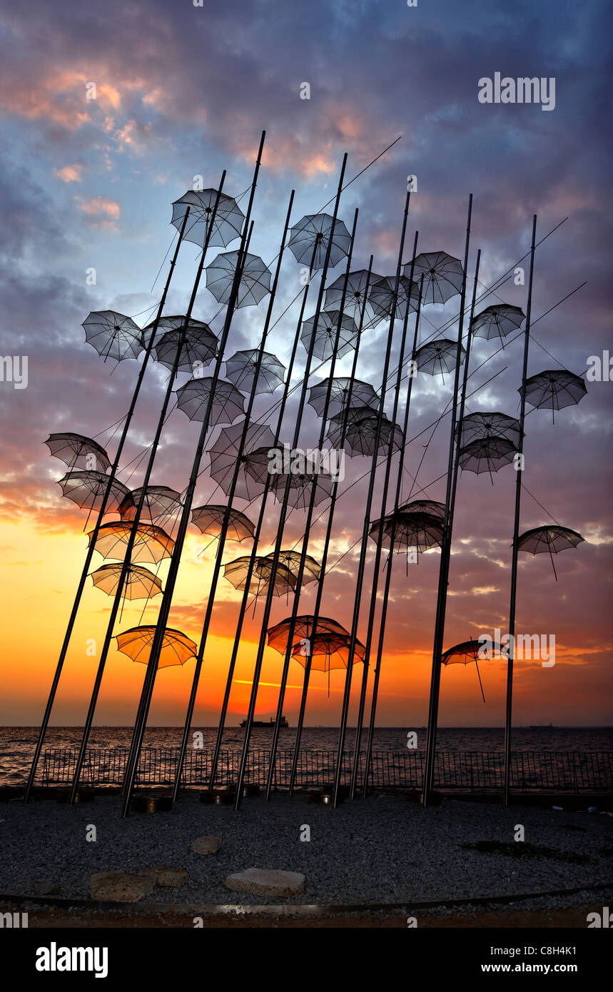 Greece, Thessaloniki.Sunset  at 'The Umbrellas' , an artistic installation, by George Zoggolopoulos. - Stock Image