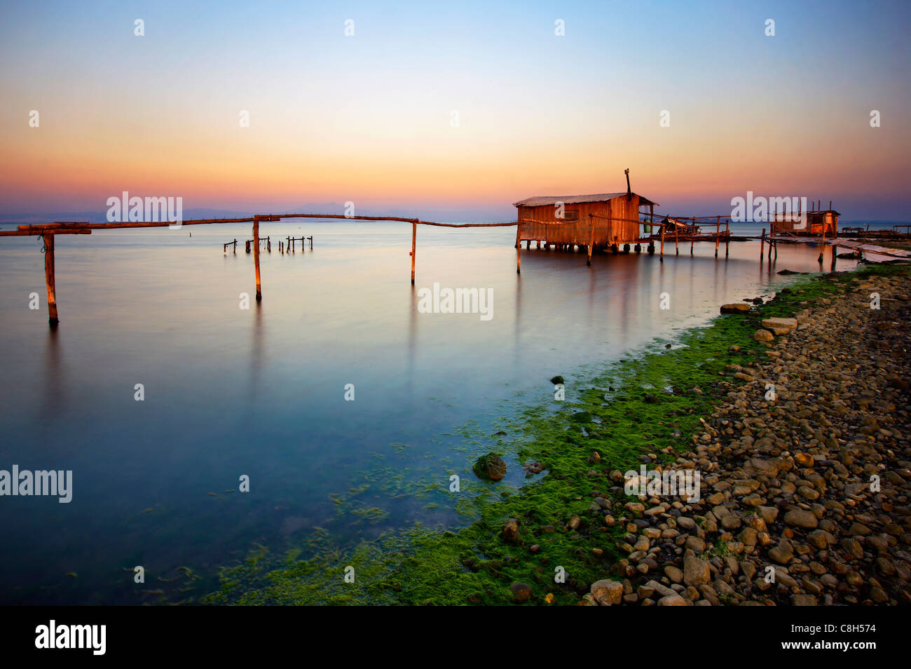 Stilt hut in the Delta of Axios (also know as 'Vardaris') river, Thessaloniki, Macedonia, Greece - Stock Image