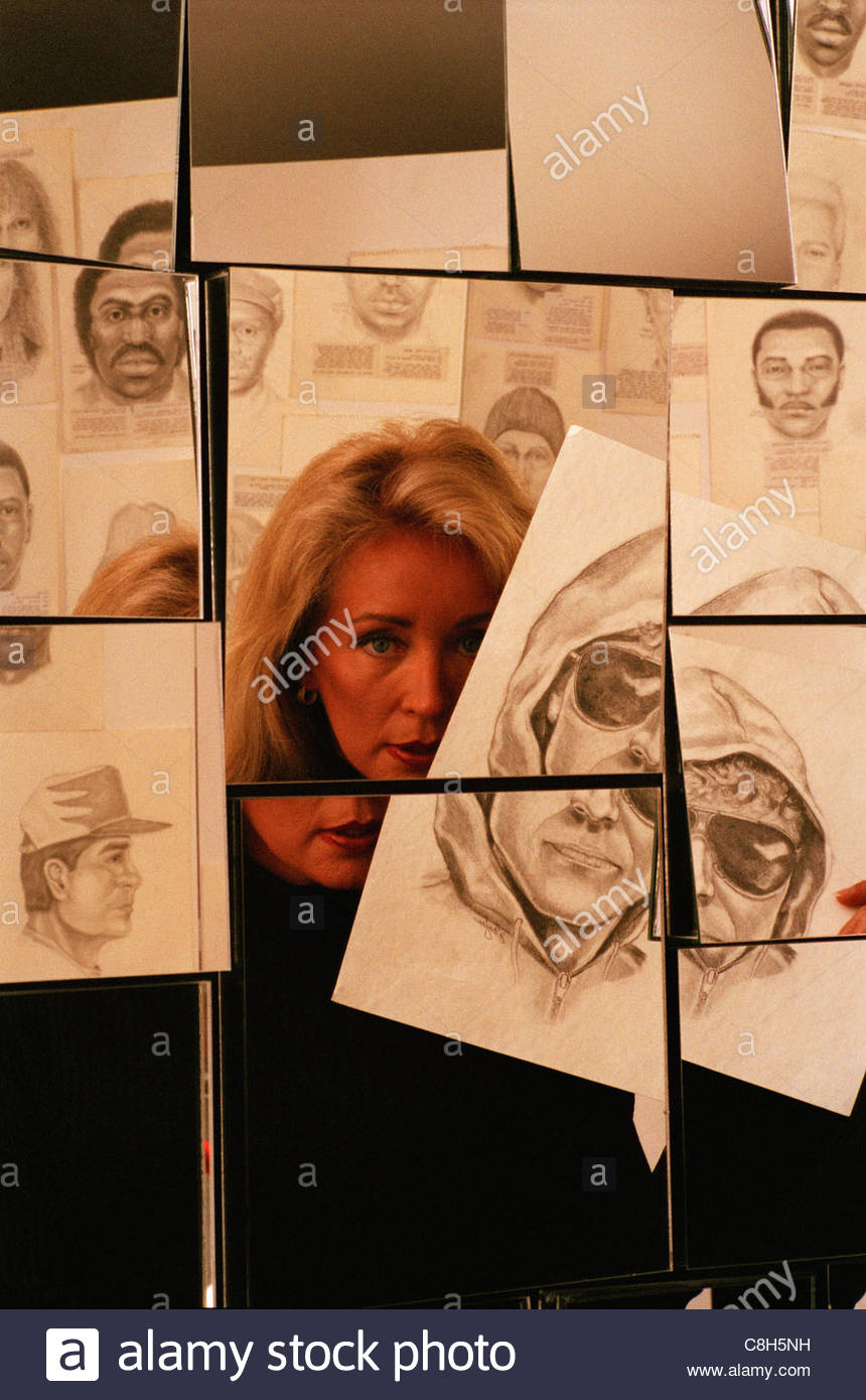A forensic artist bases her drawings on memories from within victims. - Stock Image