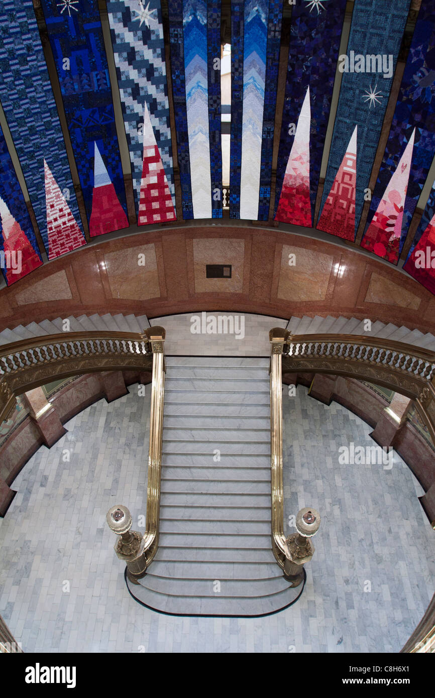Banners hanging above staircase in rotunda of Colorado capitol building in Denver - Stock Image