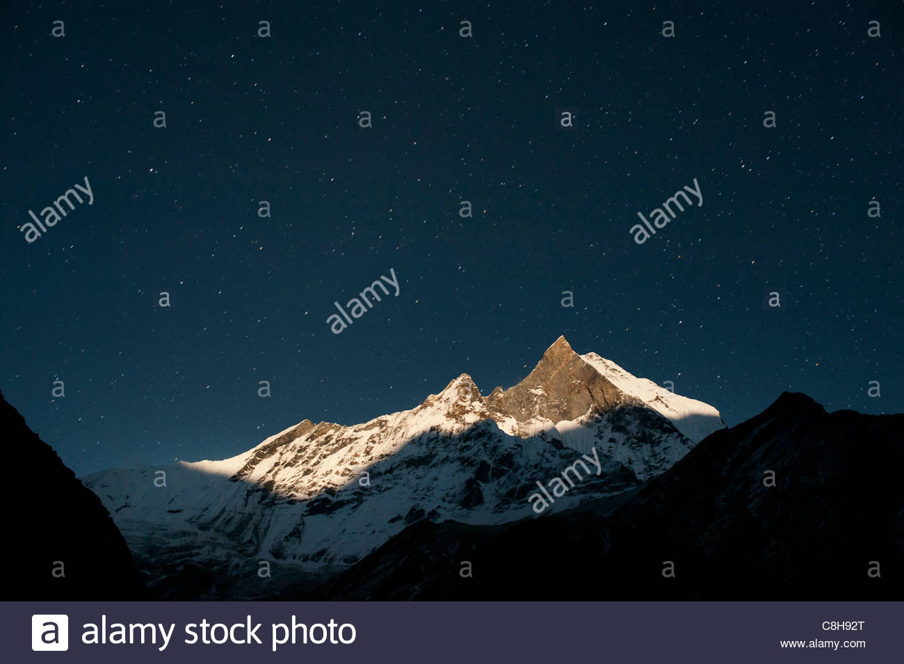 Machhapuchhare better known as the 'Fishtail' mountain by moonlight. - Stock Image