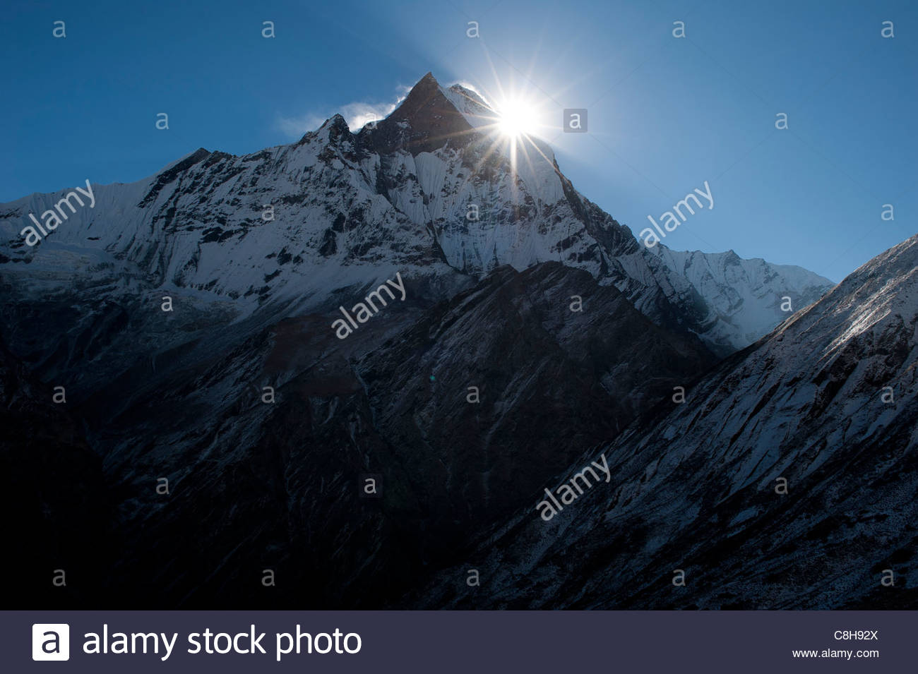 Sunrise above Machhapuchhare better known as the 'Fishtail' mountain. - Stock Image