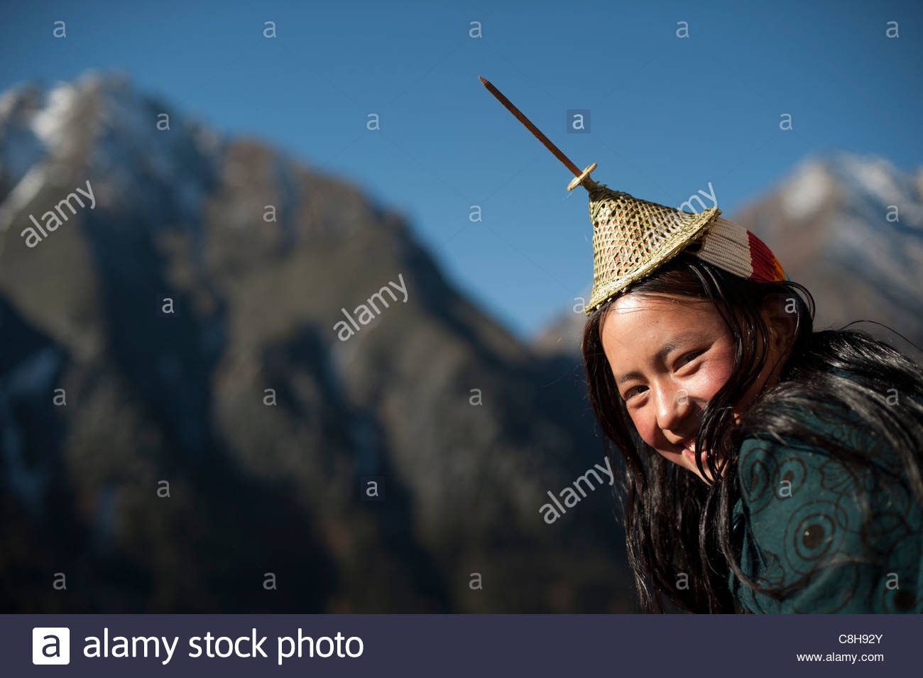 A Layap girl smiles for the camera in the remote village of Laya. Stock Photo