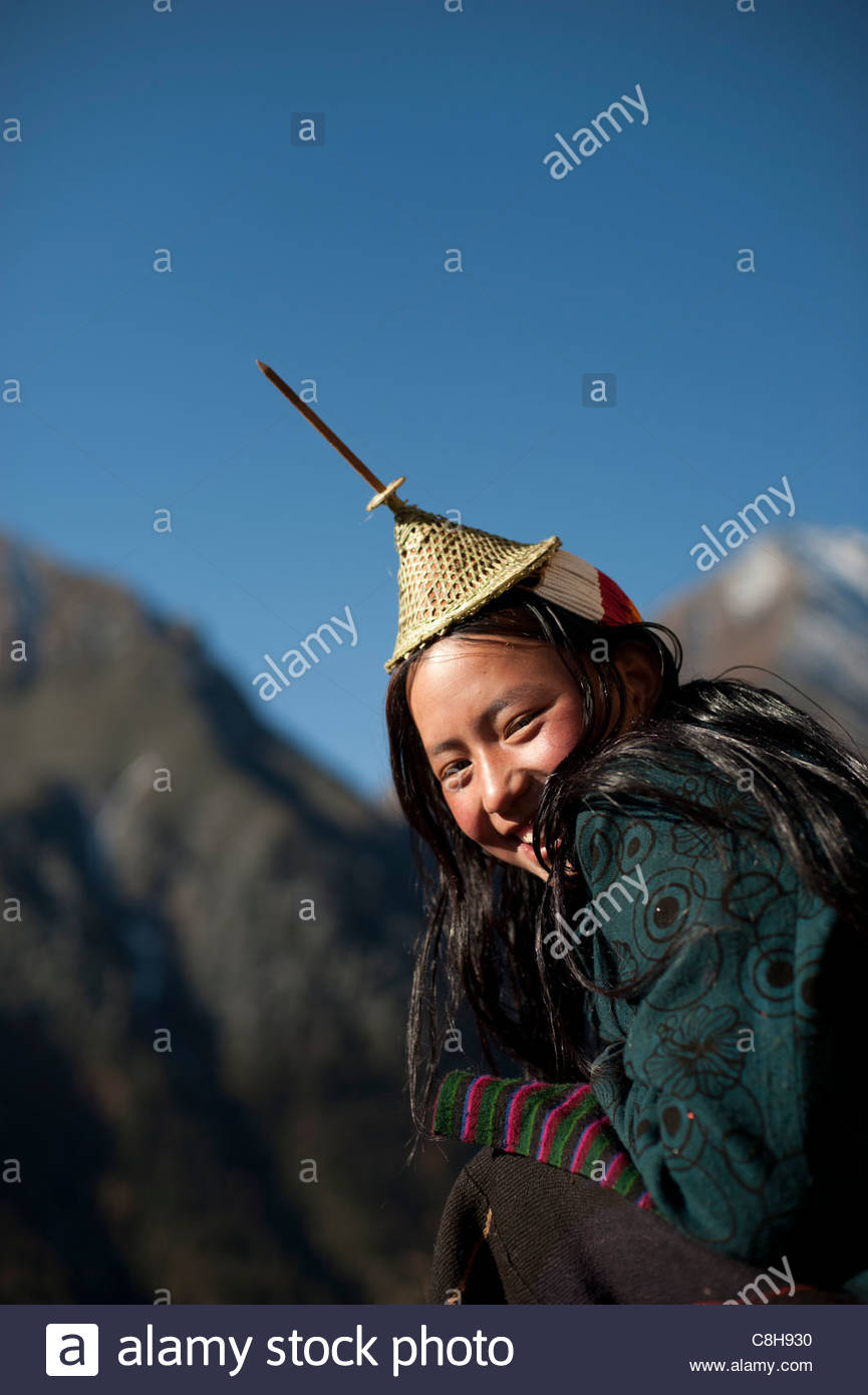 A Layap girl smiles for the camera in the remote village of Laya. - Stock Image