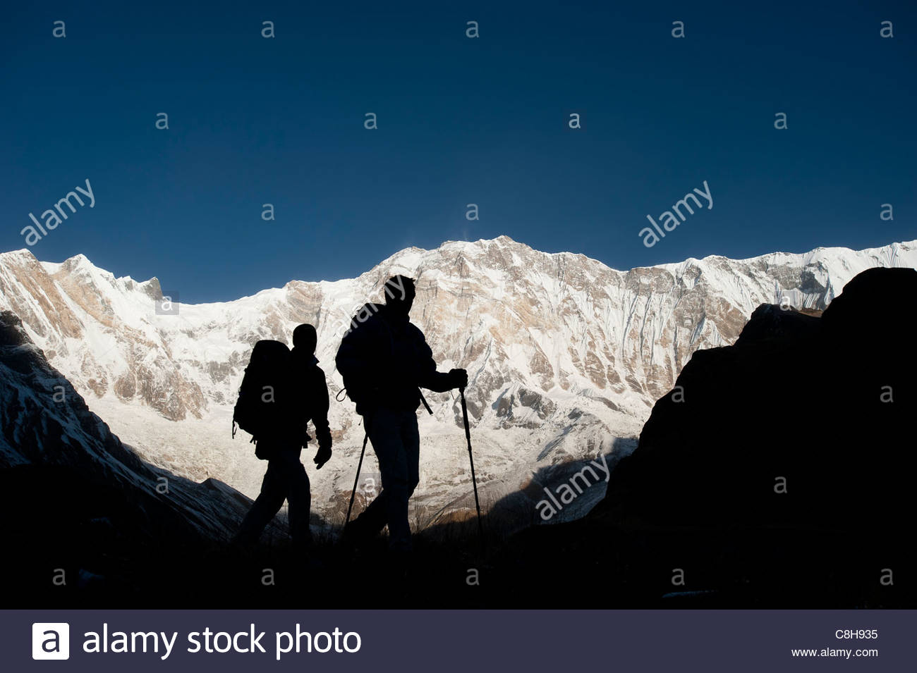 Trekkers on their way down from Annapurna base camp. - Stock Image