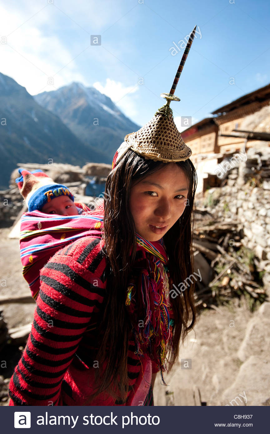A Layap girl and her baby in the remote village of Laya. - Stock Image