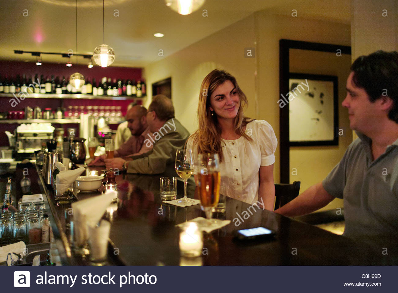A couple at 'Michael's Genuine Food & Drink' restaurant. - Stock Image