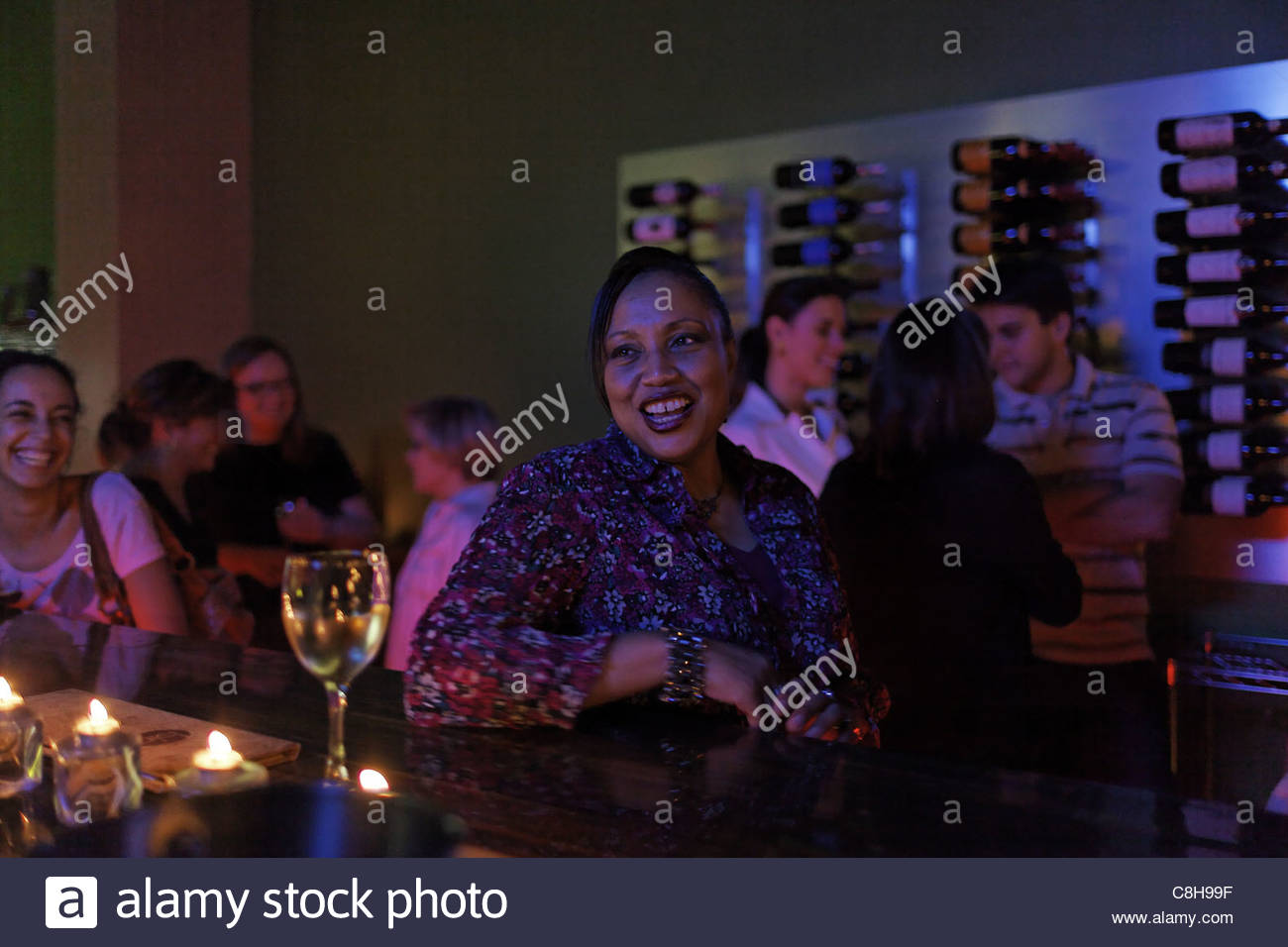 Guests at the Mediterranean Bistro, a wine and beer loft. - Stock Image