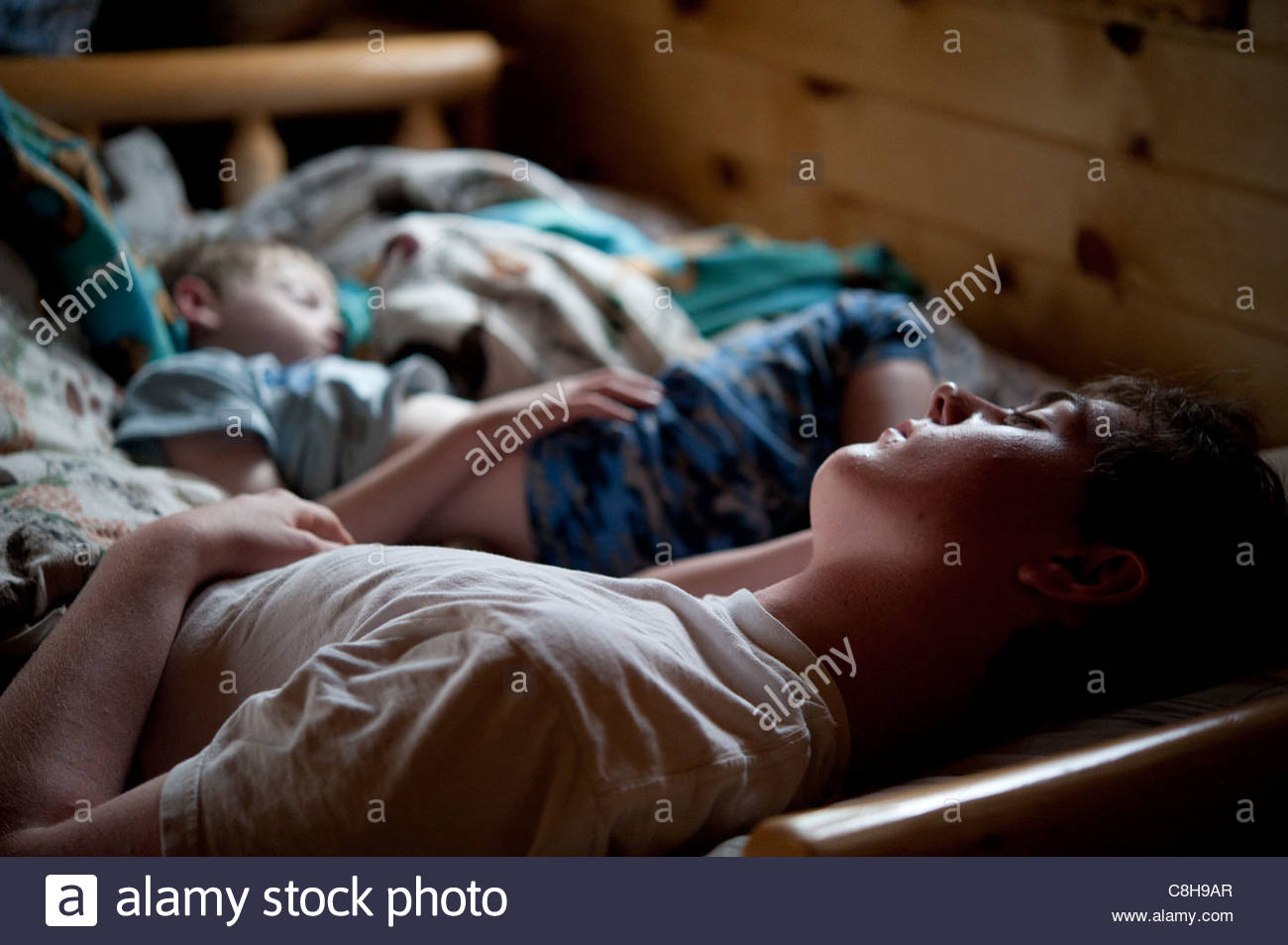 Two siblings take a nap while on vacation in Crosslake, MN. - Stock Image