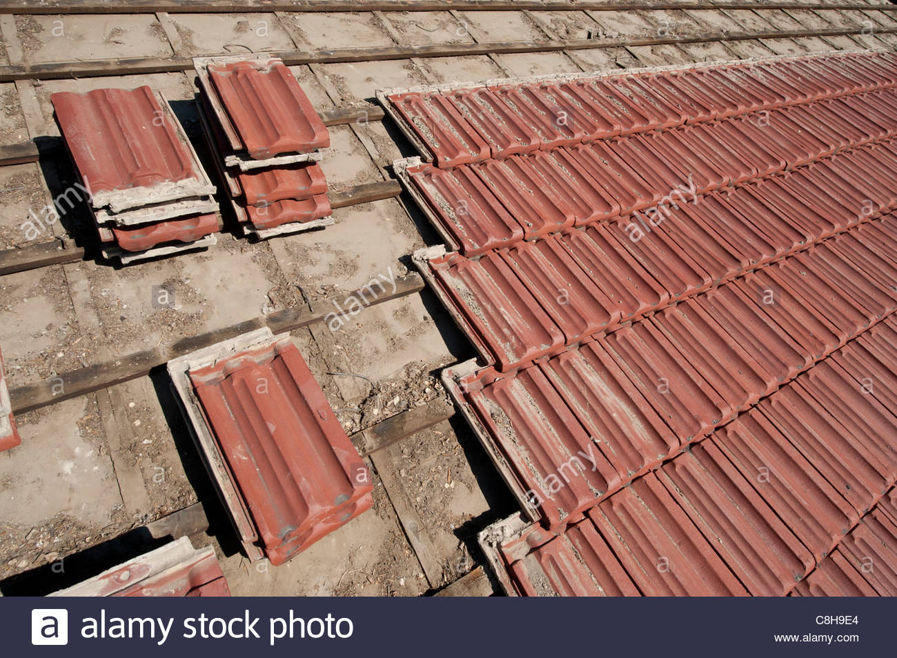 Salvaged roof tiles being removed from a roof in Lincoln, NE. Stock Photo