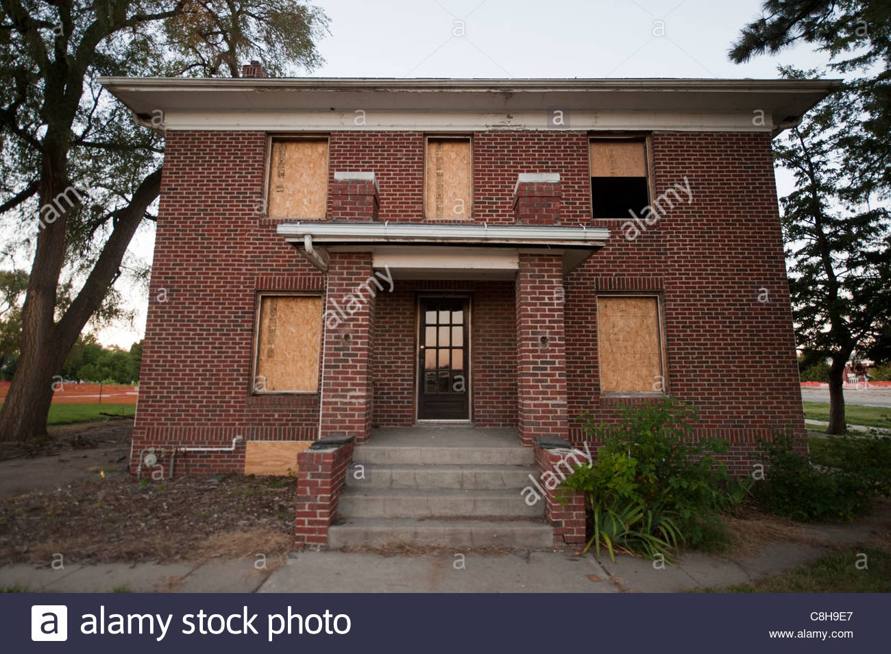 An abandoned home waiting to be demolished in Lincoln, NE. - Stock Image