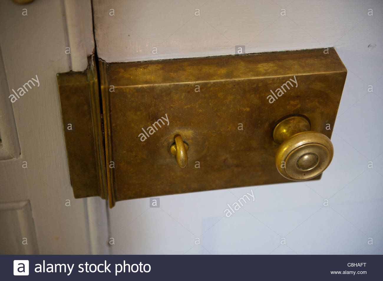 Close up of an antique lock on a door. - Stock Image