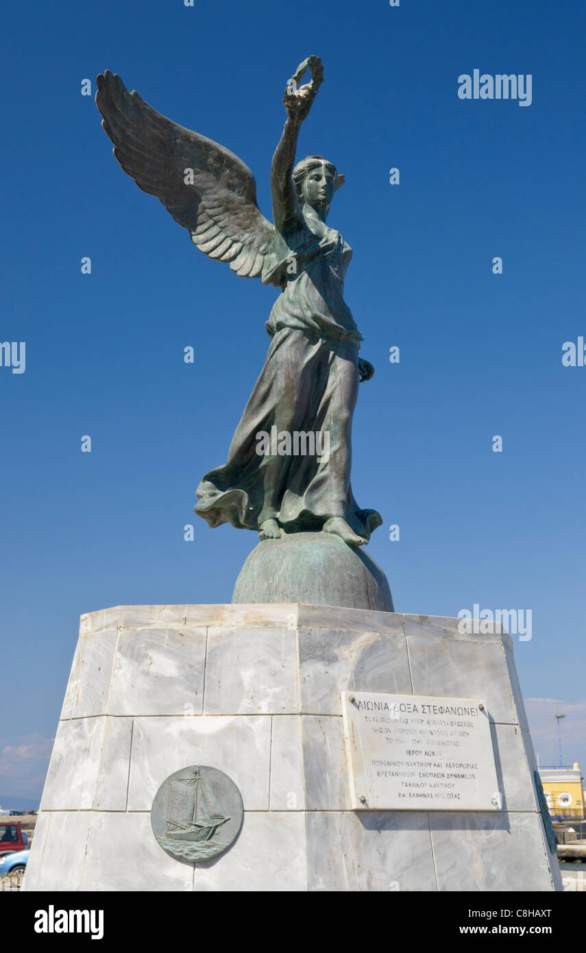 Monument to the Greek Islands liberation during WWII on the waterfront of Rhodes Town, Rhodes Island, Greece - Stock Image