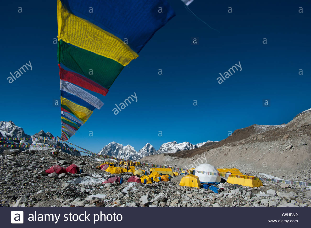 Prayer flags adorn Everest base camp - Stock Image
