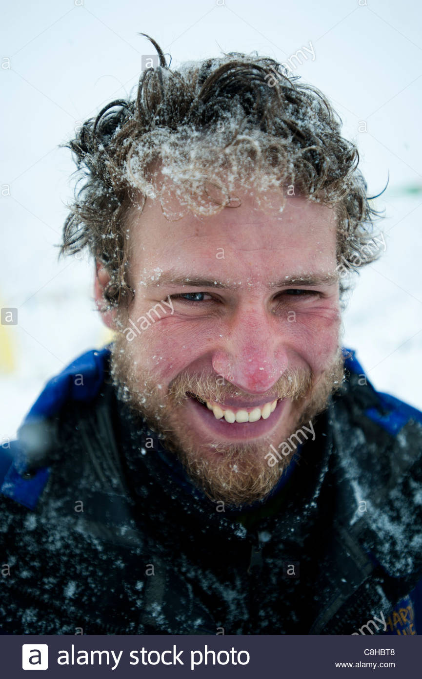 A mountaineer at base camp after successfully climbing Everest. - Stock Image