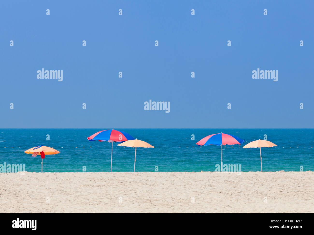 Beach Umbrellas, Jumeirah Russian Beach, Dubai, United Arab Emirates, UAE - Stock Image