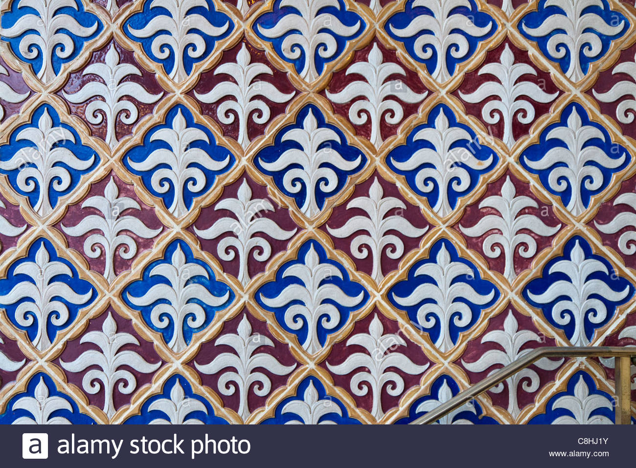 Colorful tile on an exterior wall. - Stock Image