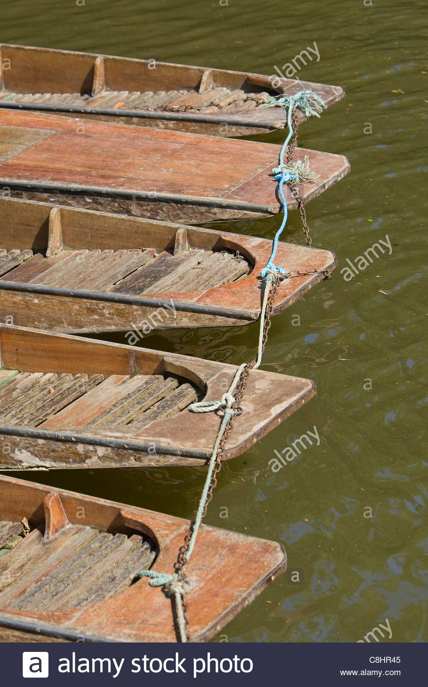 Parked boats used for punting, tied to each other. - Stock Image