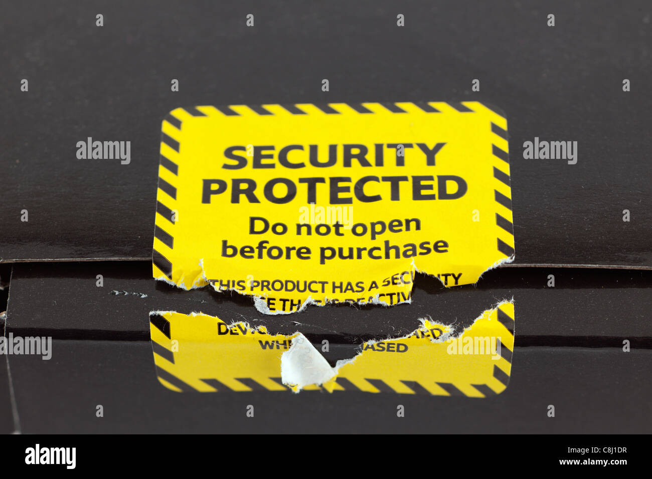 Broken security protected yellow label - Stock Image