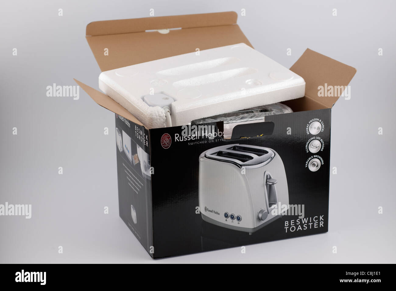 Unpacking a boxed product - Stock Image